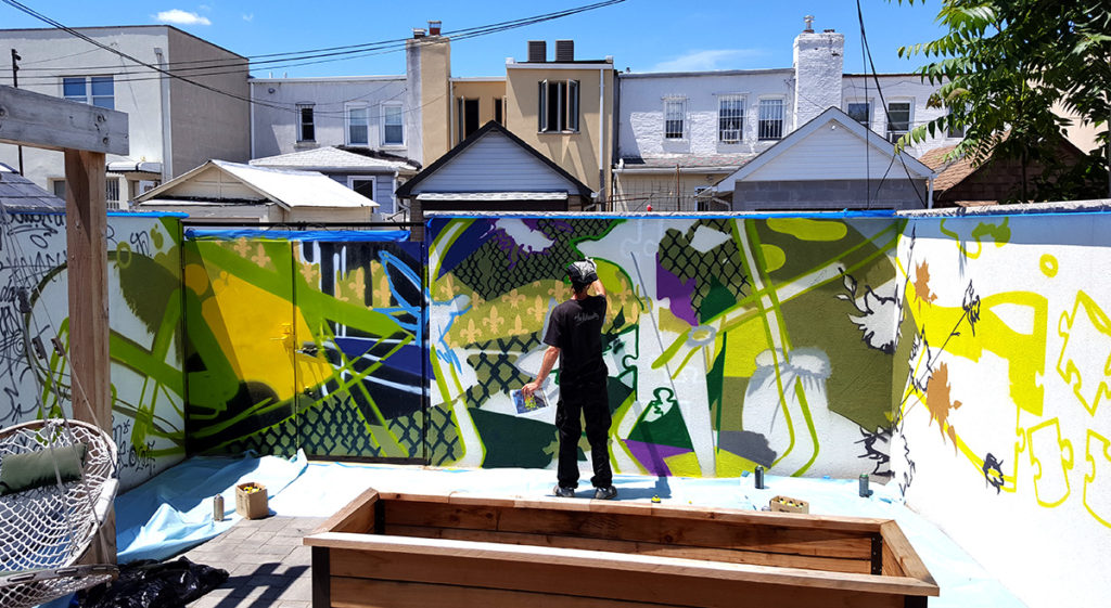 Artist Creating Queens Mural