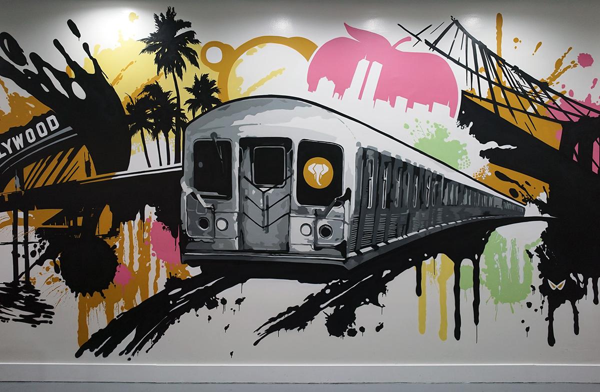Orange County Mural Artist Spray Paints Wall Art